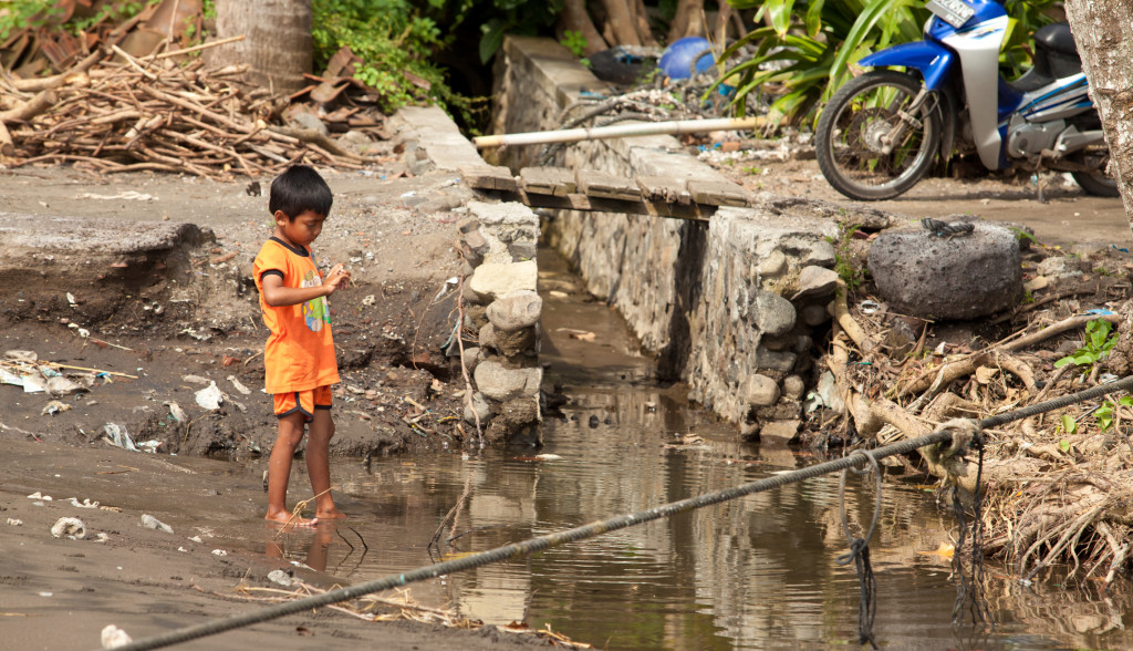 http://www.dreamstime.com/stock-photos-kid-dirty-water-image23653773